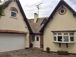 Front of House with White Painted uPVC Windows, Door and Garage