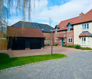 Landscape view of semi-detached house driveway